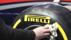 hand with napkin cleaning pirelli tyre