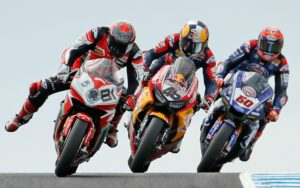 motorcycles racing turning